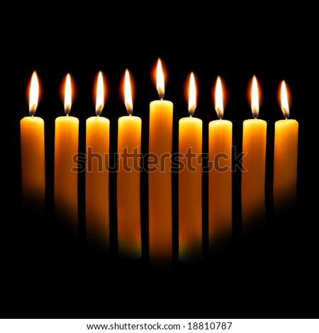 Hanukkah candles over black background with space for your text - stock photo