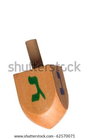 Hanukkah dreidel, isolated on white background. - stock photo