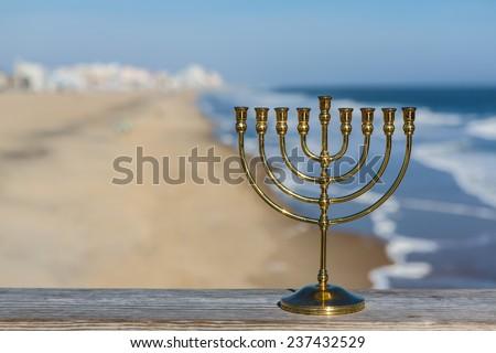 Hanukkah Menorah at the beach - stock photo