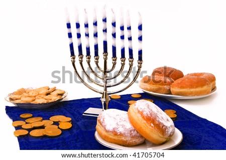 Hanukkah menorah,  donuts and coins - stock photo