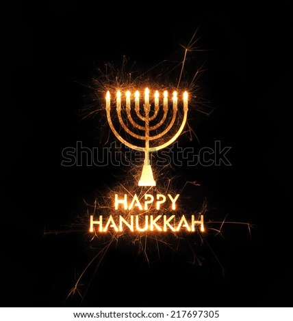 Hanukkah menorah greeting created with sparks on black background - stock photo