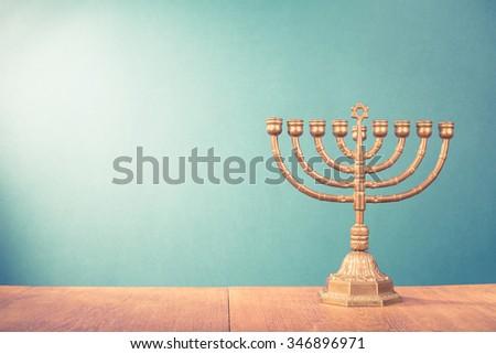 Hanukkah menorah on table. Retro old style filtered photo - stock photo