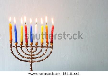 Hanukkah menorah  with Burning candles - stock photo