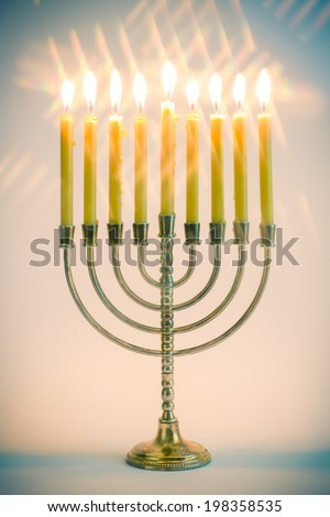 Hanukkah menorah with burning candles - stock photo