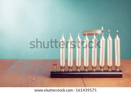 Hanukkah menorah with burning candles concept - stock photo