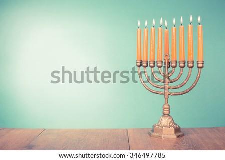 Hanukkah menorah with burning candles. Retro old style filtered photo - stock photo