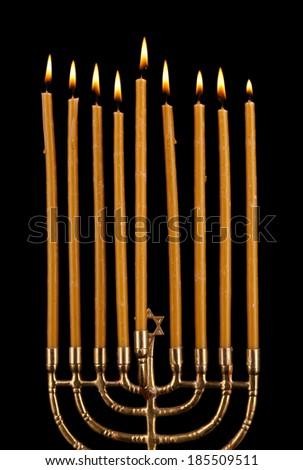 Hanukkah menorah with candles isolated on black - stock photo