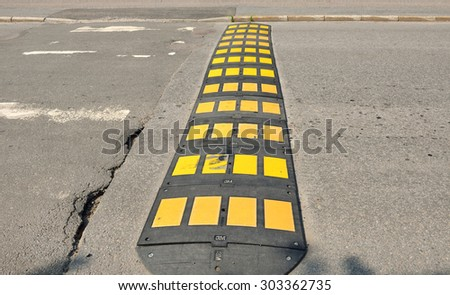 HAPARANDA,SWEDEN - JULY 11, 2015:Speed bumps are common name for family of traffic calming devices that use vertical deflection to slow motor-vehicle traffic in order to improve safety conditions - stock photo