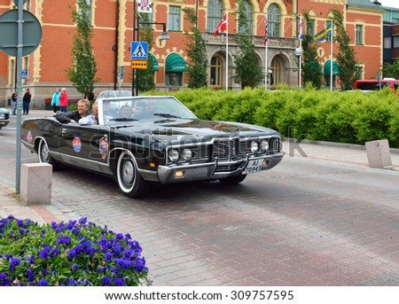HAPARANDA, SWEDEN - JULY 11, 2015:Wheels Nationals car meet draw 30000 visitors and become bigger each year. After meeting cars long go around city that all passersby could see and photograph them - stock photo