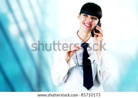 Hapiness Businesswoman standing on the business background - stock photo