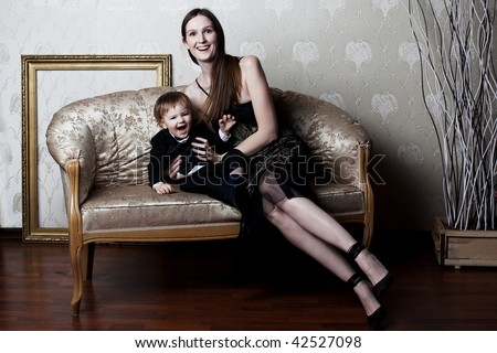 happe mother and her little son having fun - stock photo