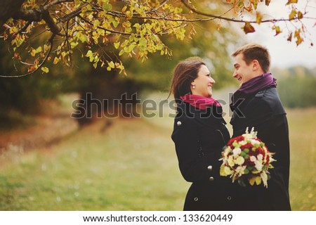 Happe young couple laughing. Sunny autumn day - stock photo