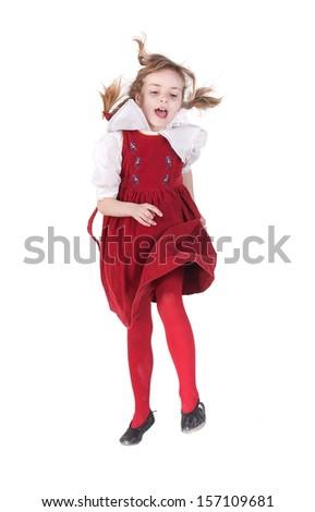 Happi little girl in red dress jumping over white - stock photo