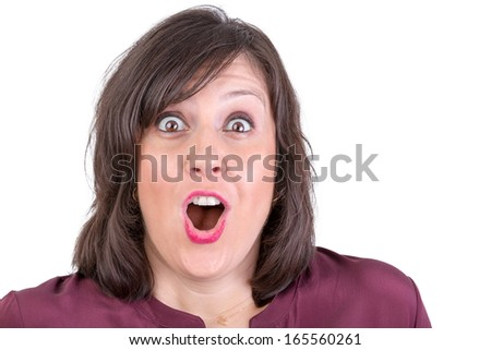 Happily amazed dark haired lady looking in to your eyes with her mouth wide open - stock photo