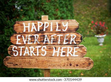 Happily ever after sign on wooden board - wedding venue or honeymoon sign - stock photo