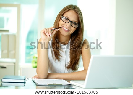Happily smiling business lady posing for a portrait - stock photo