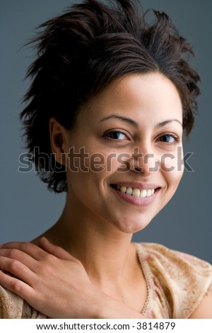 happily smiling mulatto woman looking into the camera