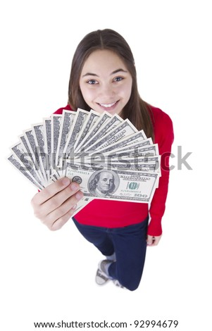 Happily smiling teenager girl says I got my tax money. - stock photo