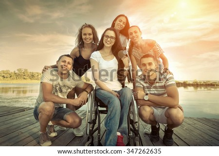 Happines group of Friedns on the wooden pier. - stock photo