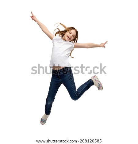 happiness, activity and child concept - smiling little girl jumping - stock photo
