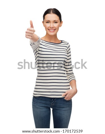 happiness and people concept - smiling girl in casual clothes showing thumbs up - stock photo