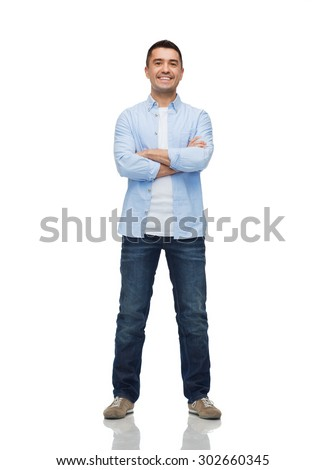 happiness and people concept - smiling man with crossed arms - stock photo