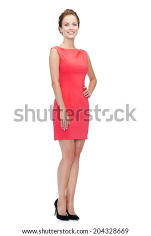 happiness and people concept - smiling young woman in red dress - stock photo