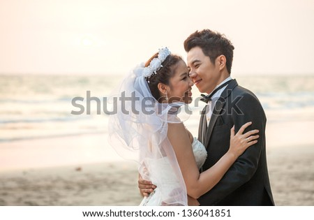 happiness and romantic Scene of love couples partners wedding on the Beach - stock photo