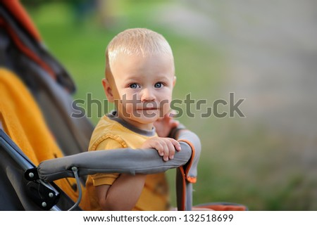 Happiness Baby boy sitting on carriage