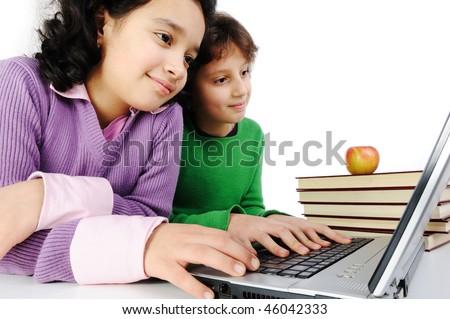 Happiness, beautiful childhood, two beauty girls on laptop - stock photo