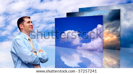 Happiness business man on blue sky background - stock photo