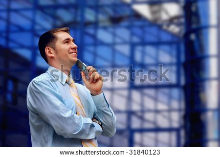 Happiness business men with telephone, look on business architecture background - stock photo