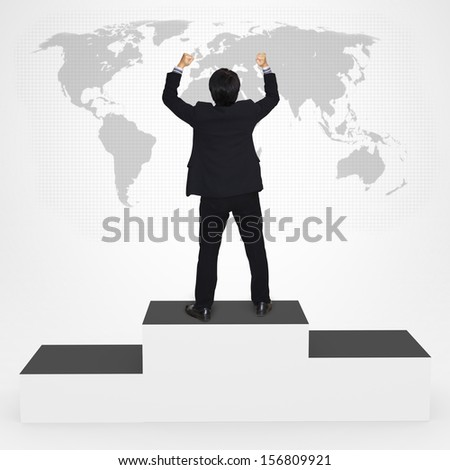 Happiness businesses man standing on top of winner podium, Success in business concept