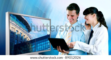 Happiness businessman and businesswoman and display - stock photo