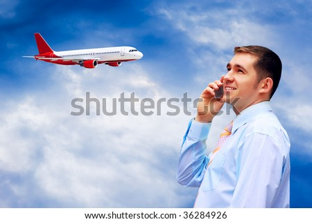 Happiness businessman on blue sky with airplane - stock photo