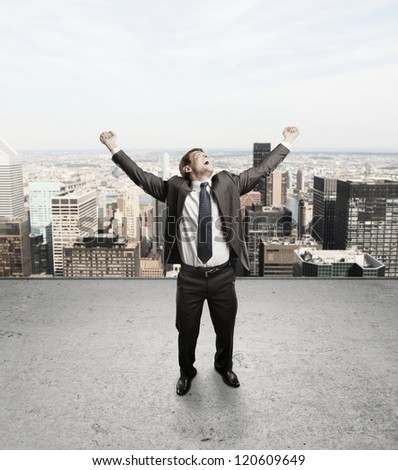 happiness businessman on concrete  roof - stock photo