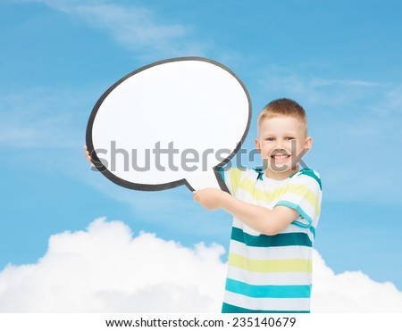 happiness, childhood, conversation and people concept - smiling little boy with blank text bubble over blue background - stock photo