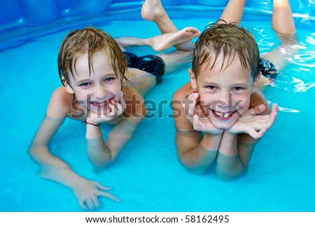 Happiness children at pool - stock photo