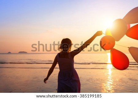 happiness concept, happy girl with multicolored balloons, joy and positive emotions - stock photo