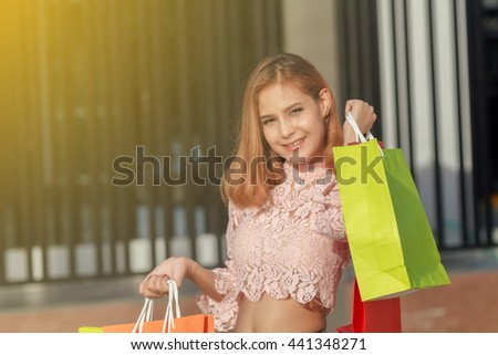 happiness, consumerism, sale and people concept - smiling young woman asian with shopping bags,soft focus - stock photo