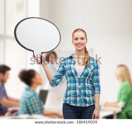 happiness, conversation and people concept - smiling young woman with blank text bubble - stock photo