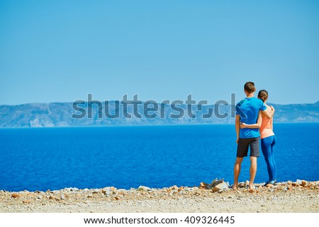 happiness couple  under blue sky - stock photo