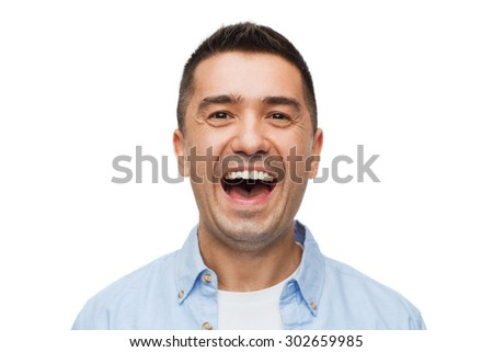 happiness, emotions and people concept - laughing man - stock photo