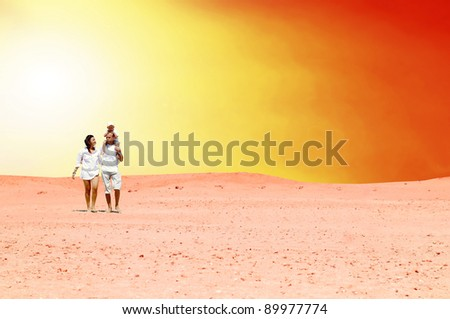 Happiness family fun in desert in sunny day - stock photo