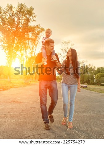Happiness family outdoor - stock photo