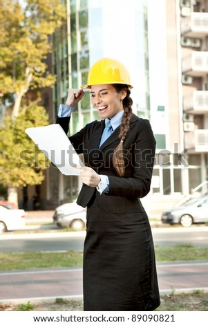 happiness  female architect, looking in document with good news - stock photo