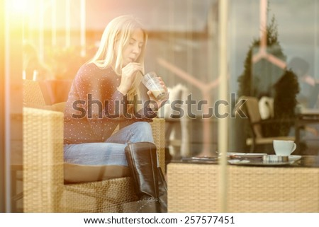 Happiness female with coffee. View through glass. - stock photo