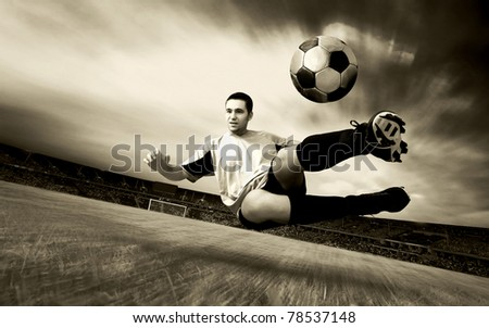 Happiness football player on field of olimpic stadium on sunrise sky - stock photo