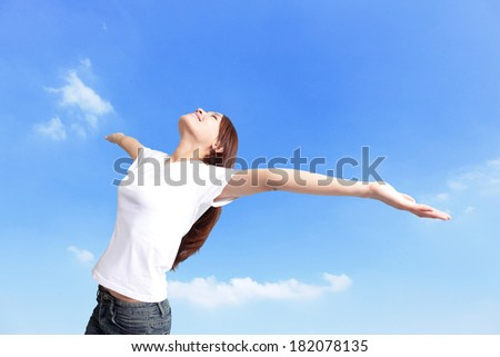Happiness freedom concept. Woman happy smiling with arms up, asian beauty - stock photo