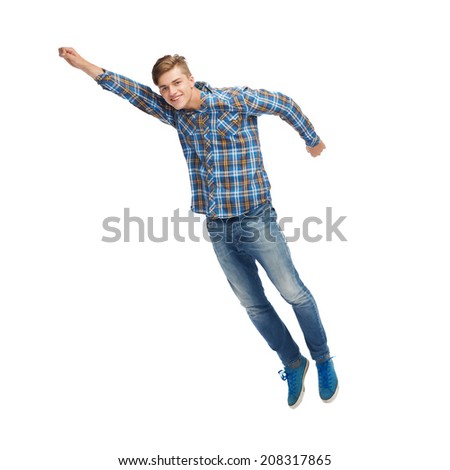 happiness, freedom, movement and people concept - smiling young man flying in air - stock photo